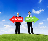 Two Businessmen Holding Wrong and Right Stock Photo