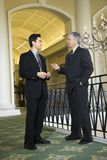 Two businessmen in hotel. Stock Image