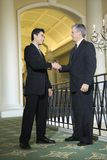 Two Businessmen In Hotel. Royalty Free Stock Image