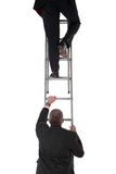 Two businessmen on a ladder Royalty Free Stock Image