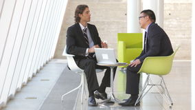 Two Businessmen With Laptop Having Meeting stock video footage