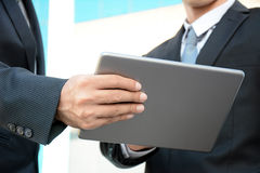 Two businessmen looking at tablet computer Royalty Free Stock Photos