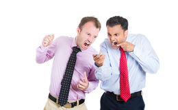 Two businessmen looking very mad and angry, both yelling on a phone Royalty Free Stock Photo
