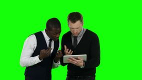 Two businessmen lose their bets. Green screen stock video