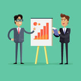 Two Businessmen Make a Presentation. Two businessmen in business suit and tie making a presentation in front of whiteboard with infographics. Smiling young men Stock Images