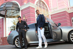 Two Businessmen Near Luxury Car Royalty Free Stock Images