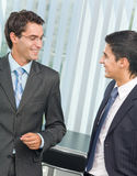 Two businessmen at office Stock Photos