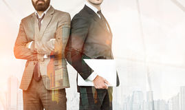 Two businessmen in office with skyscrapers Royalty Free Stock Image