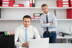 Two Businessmen In An Office Smiling Royalty Free Stock Photos