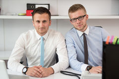 Two Businessmen In An Office Smiling Royalty Free Stock Image