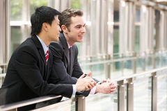 Two Businessmen Outside Modern Office Royalty Free Stock Photos