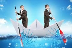 Two businessmen in paper boat Royalty Free Stock Images