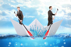 Two businessmen in paper boat Royalty Free Stock Photos