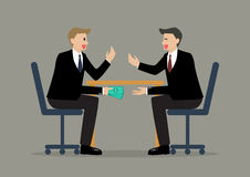 Two Businessmen Passing Money Under the Table Stock Images