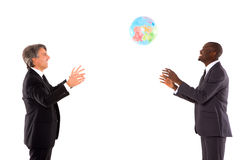 Two businessmen playing with a globe Royalty Free Stock Photography