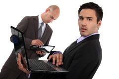 Two businessmen preparing sales pitch Royalty Free Stock Photos