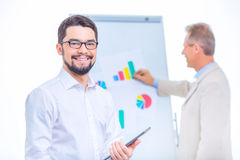 Two businessmen presenting chart materials Stock Photography