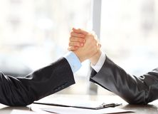 Two businessmen press hands Royalty Free Stock Photography