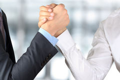 Two businessmen press hands each other on a forward background.  stock photos