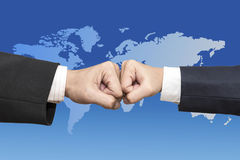 Two businessmen punch hands each other isolated on white background stock photos