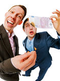 Two businessmen ready to set on fire euro banknote Royalty Free Stock Photos