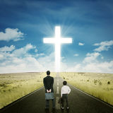 Two businessmen on the road with a cross. Two businessmen standing on the road while looking at the cross royalty free stock images