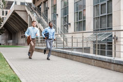 Two businessmen running Royalty Free Stock Images