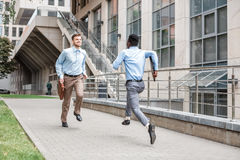 Two businessmen running to meet each other Royalty Free Stock Photo
