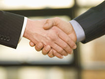 Two businessmen shake hands. Stock Image