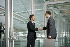 Two businessmen shake hands. stock photos
