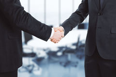 Two businessmen shake hands Stock Image