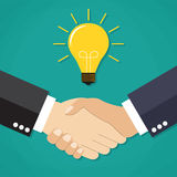 Two businessmen shake hands for a deal Royalty Free Stock Images