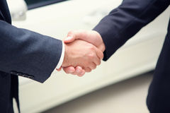 Two businessmen shaking hands. Close-up shot of two businessmen shaking hands Royalty Free Stock Photography
