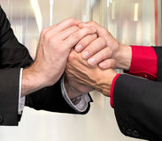 Two businessmen shaking hands Stock Photos