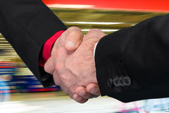 Two businessmen shaking hands Stock Images