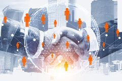 Handshake in gray city, people network. Two businessmen shaking hands in city with double exposure of global people network hologram. International business stock illustration