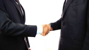 Two businessmen shaking hands. Handshake two businessmen shaking hands high definition video stock video footage