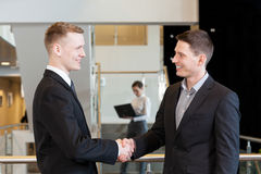 Two businessmen shaking hands. Horizontal view of a two businessmen shaking hands Royalty Free Stock Photography