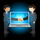 Two businessmen shaking hands and laptop Royalty Free Stock Image