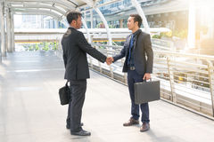 Two Businessmen are shaking hands Stock Images