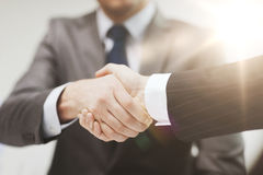 Two businessmen shaking hands in office Royalty Free Stock Images