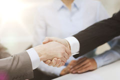 Two businessmen shaking hands in office Royalty Free Stock Photography