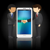 Two businessmen shaking hands and smart phone Stock Photography