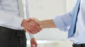 Two businessmen shaking their hands stock video