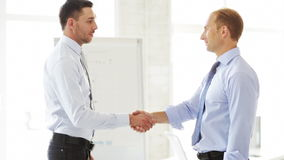 Two businessmen shaking their hands Stock Image