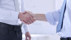 Two businessmen shaking their hands. Business handshake - two businessmen shaking their hands stock video footage
