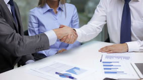 Two businessmen shaking their hands Royalty Free Stock Photography
