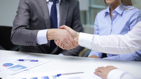 Two businessmen shaking their hands. Business handshake concept - two businessmen shaking their hands stock footage