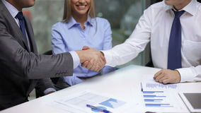 Two businessmen shaking their hands. Business handshake concept - two businessmen shaking their hands stock video footage