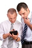 Two businessmen in shirts, looking down with concern and consult Stock Photography